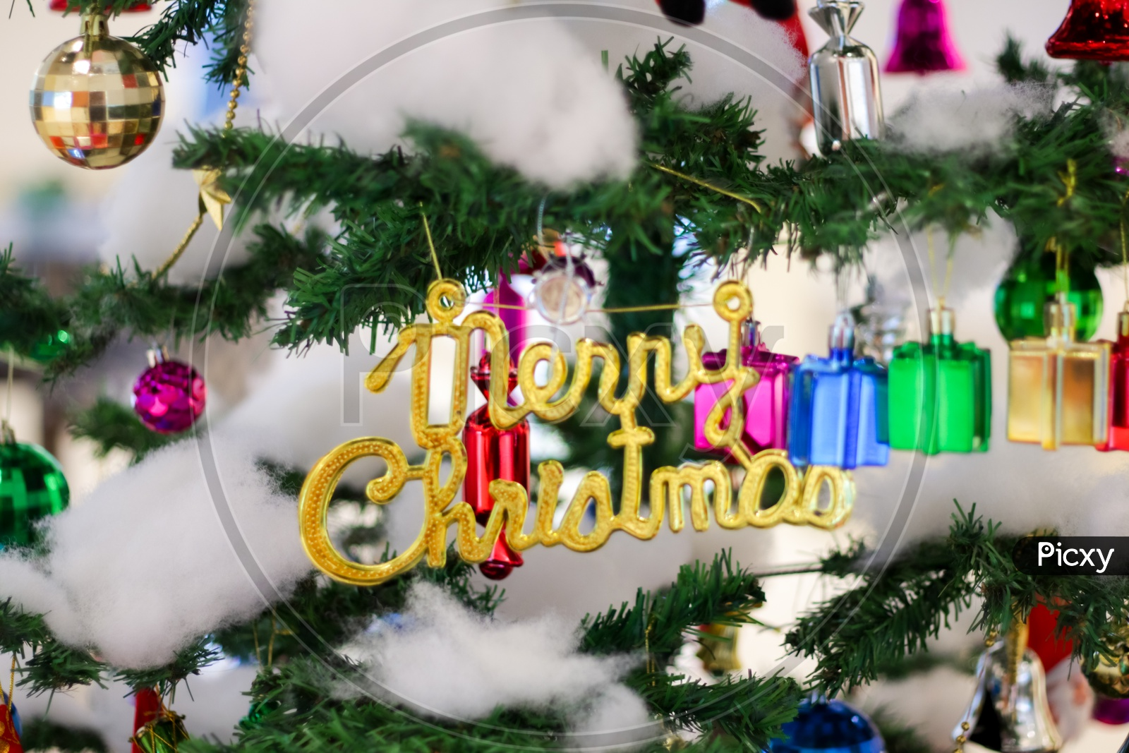 Christmas Decoration With Gift Bells Balls Boxes Boots Stars With Christmas Tree And Cotton With Blurred Background