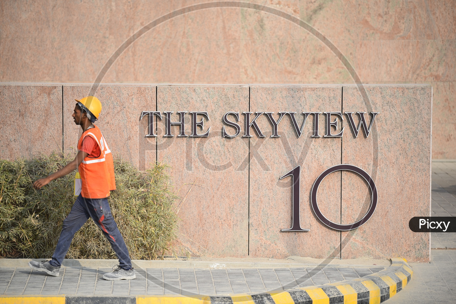 A Construction Worker walking on Footpath at THE SKYVIEW 10, Hyderabad