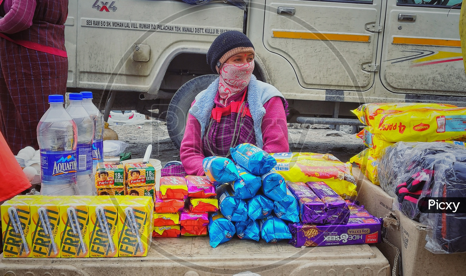 Shop Keeper In Mountains Selling Maggi And Biscuits.