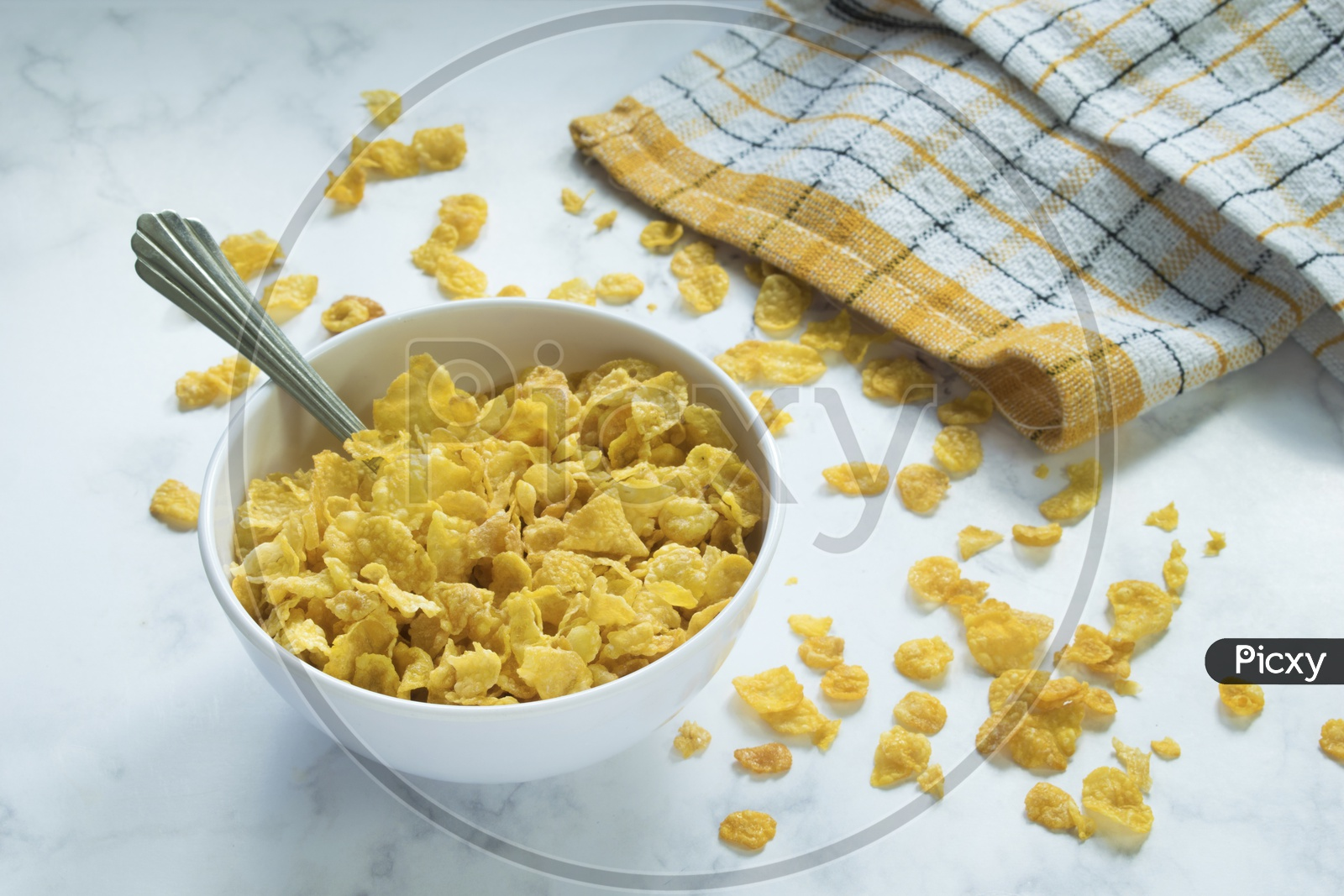 Corn Flakes Filled A Bowl And Placed On A White Marble.