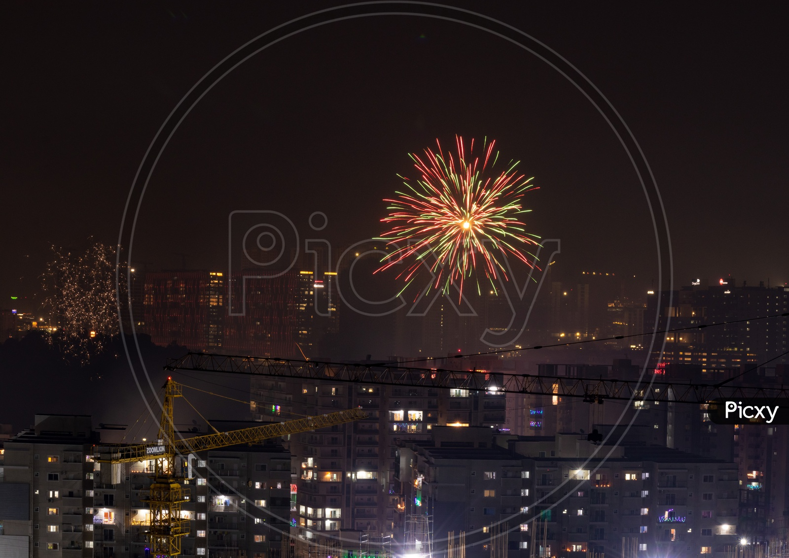 Indian Festival Diwali Deepavali Celebrations In Hyderabad With Crackers Bursting In The Sky On Top Of High Rise Buildings
