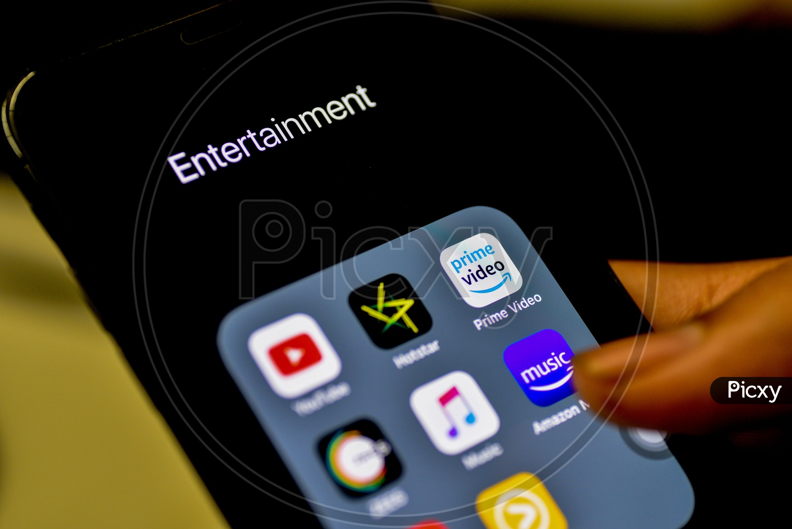 Entertainment Online Streaming Apps Installed Icons  On A Smartphone Screen Closeup With Selective Focus