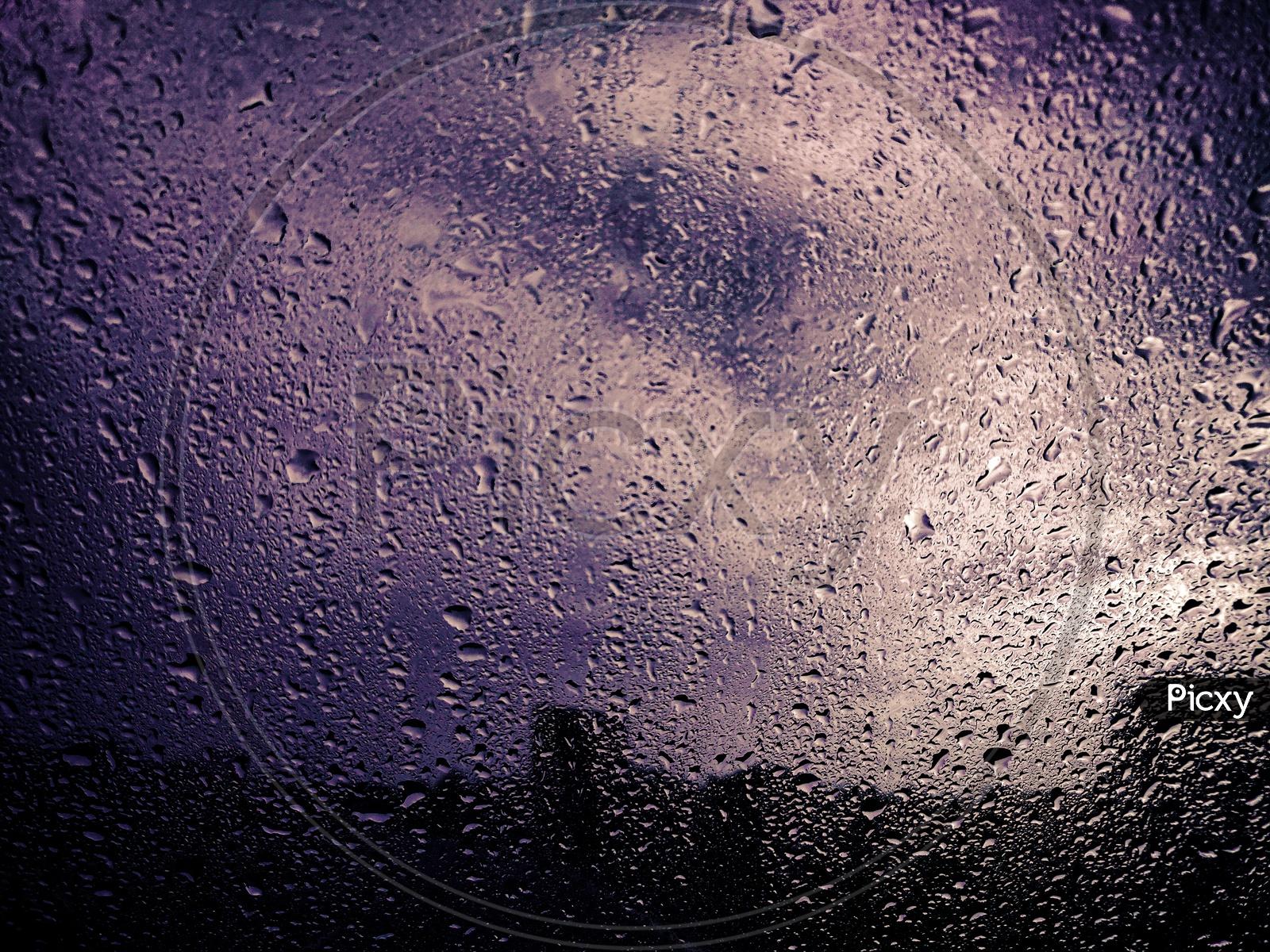 Rain Droplets On A Window Glass Shield