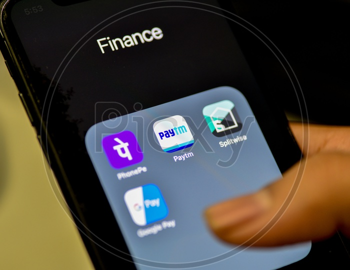 Online Payment, UPI or Bhim Payment and Transaction Apps Installed Icons On a Smartphone Screen Closeup
