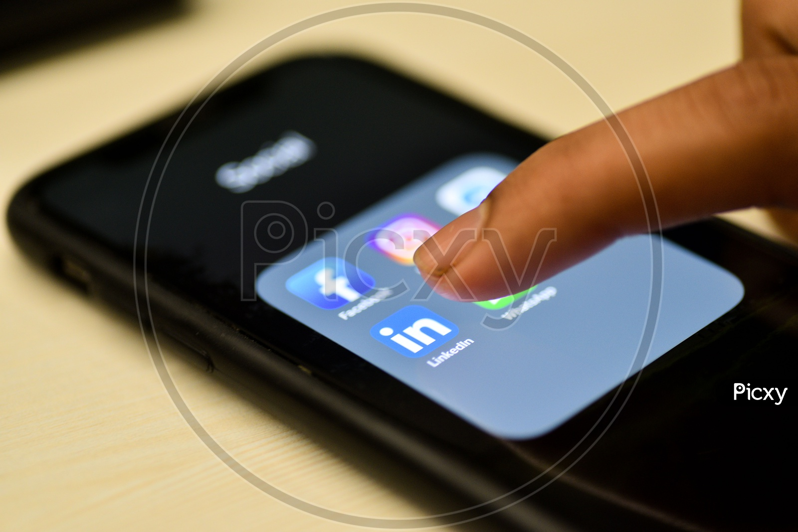 Social Network Apps On a Smartphone Screen Closeup With Man Finger On Linkedin  Icon