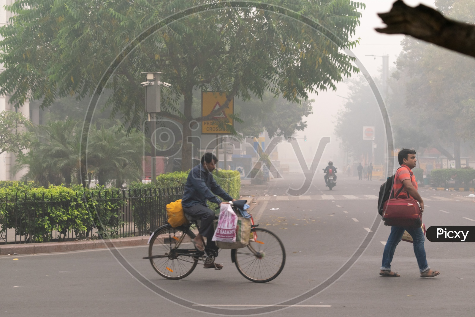 A Man Riding Bicycle During Hazy Morning Due To Pollution(Smog) At Severe Level In Delhi Ncr After Diwali