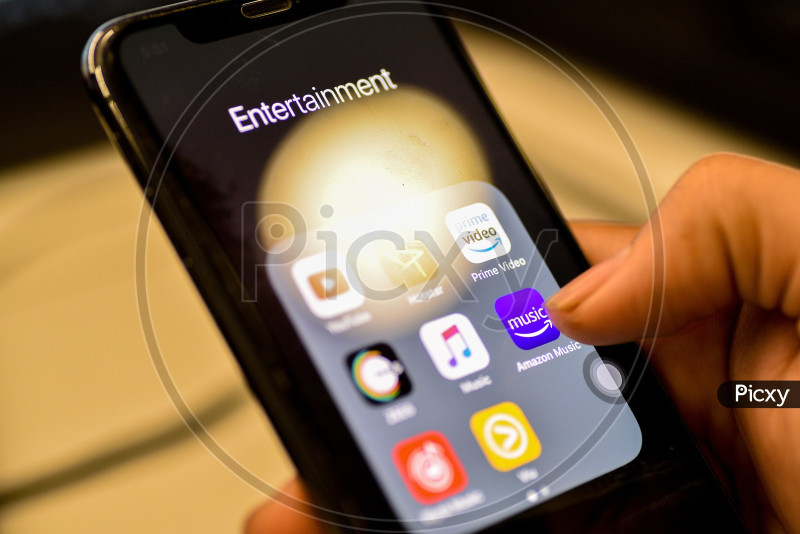 Entertainment Online Music Streaming Apps Installed Icons  On a Smartphone Screen Closeup With Man Finger Opening Amazon Music  App