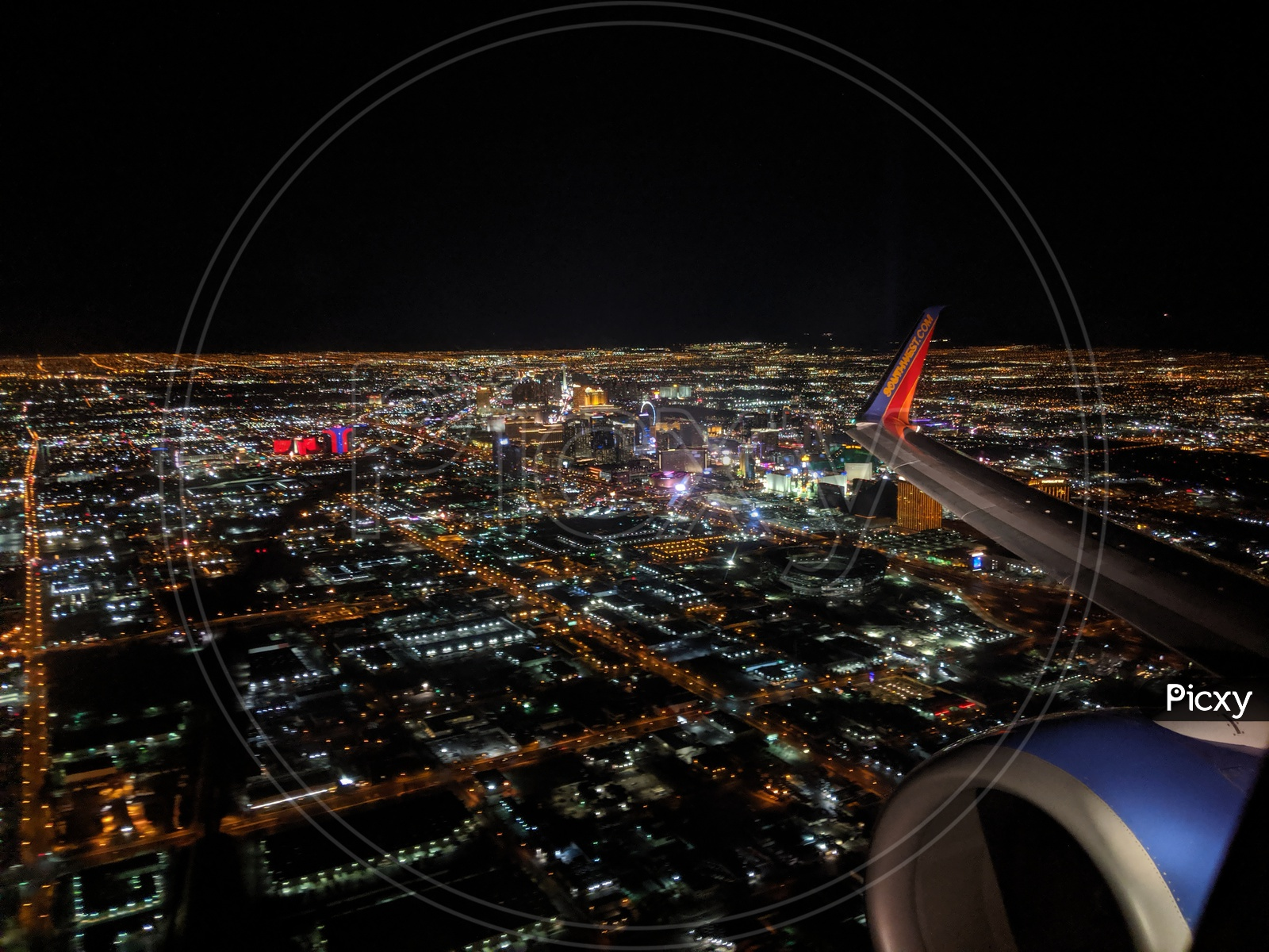 Aerial View Of Las Vegas City Night  Scape From Flight Window