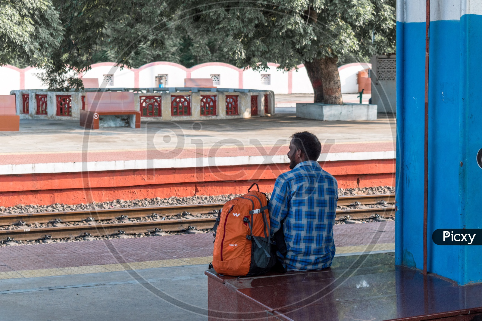 Man Sitting At Railway Station
