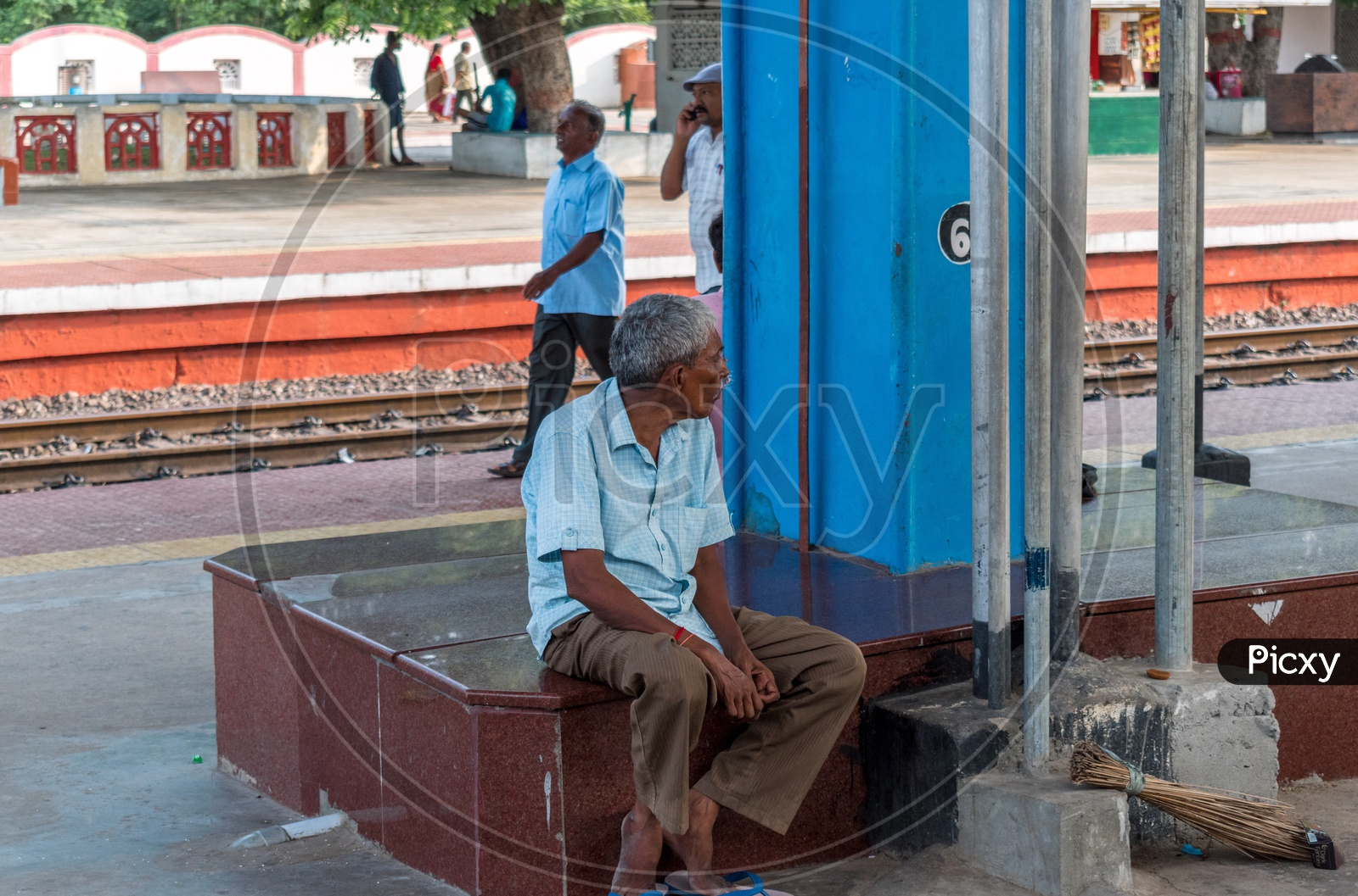 Man sitting at railway station