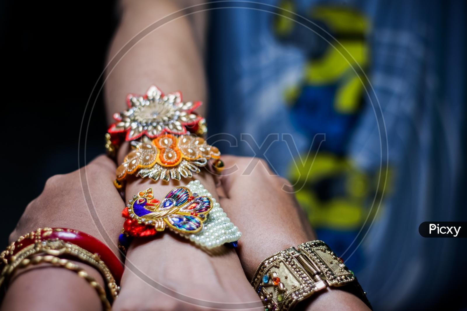 Sister Tying Rakhi To A Brother Hand  During Traditional  Hindu Festival Raksha Bandhan