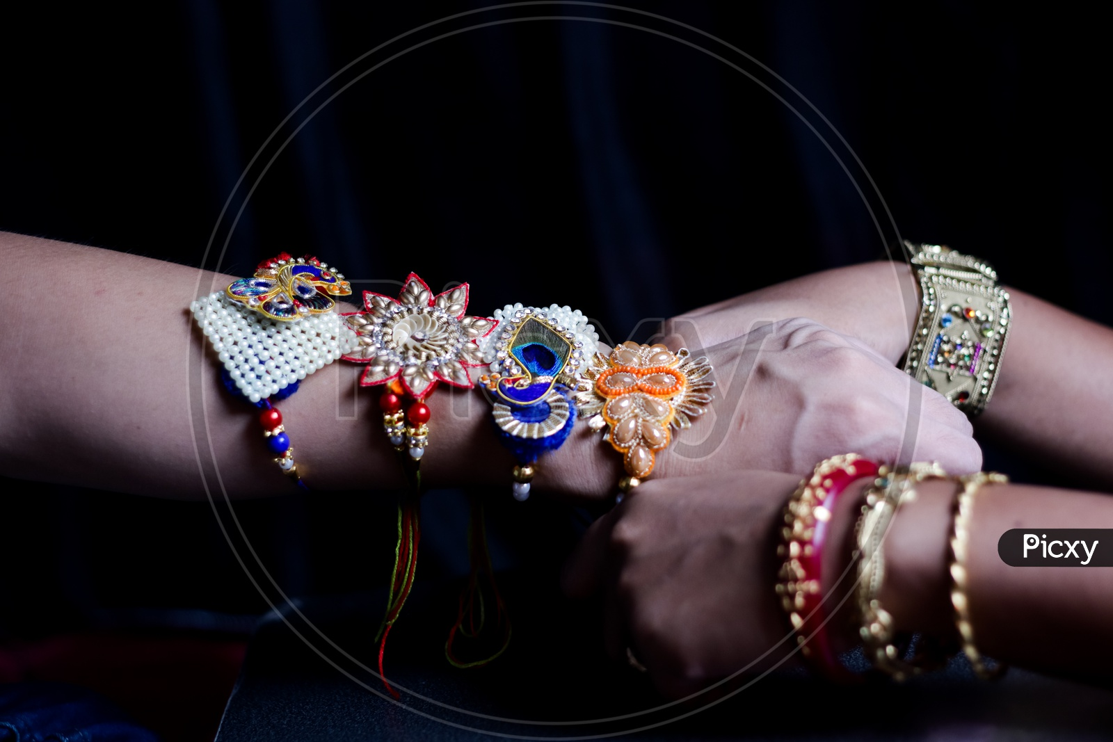Sister Tying Rakhi To a brother Hand  During Traditional  Hindu Festival Raksha Bandhan  Over a Dark Black Background