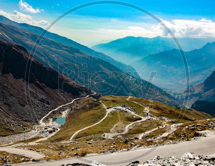 Landscape Showing Blue Sky Mountains And Roads Across The Himalaya Mountain For Travel Holiday At Kashmir Ladakh India