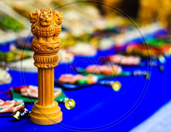 Miniature Wooden Replica Of Ashoka Stambha. An Ancient Historic Indian Monument.Lion Face Pliiar Of Ashoka, Indian National Emblem.