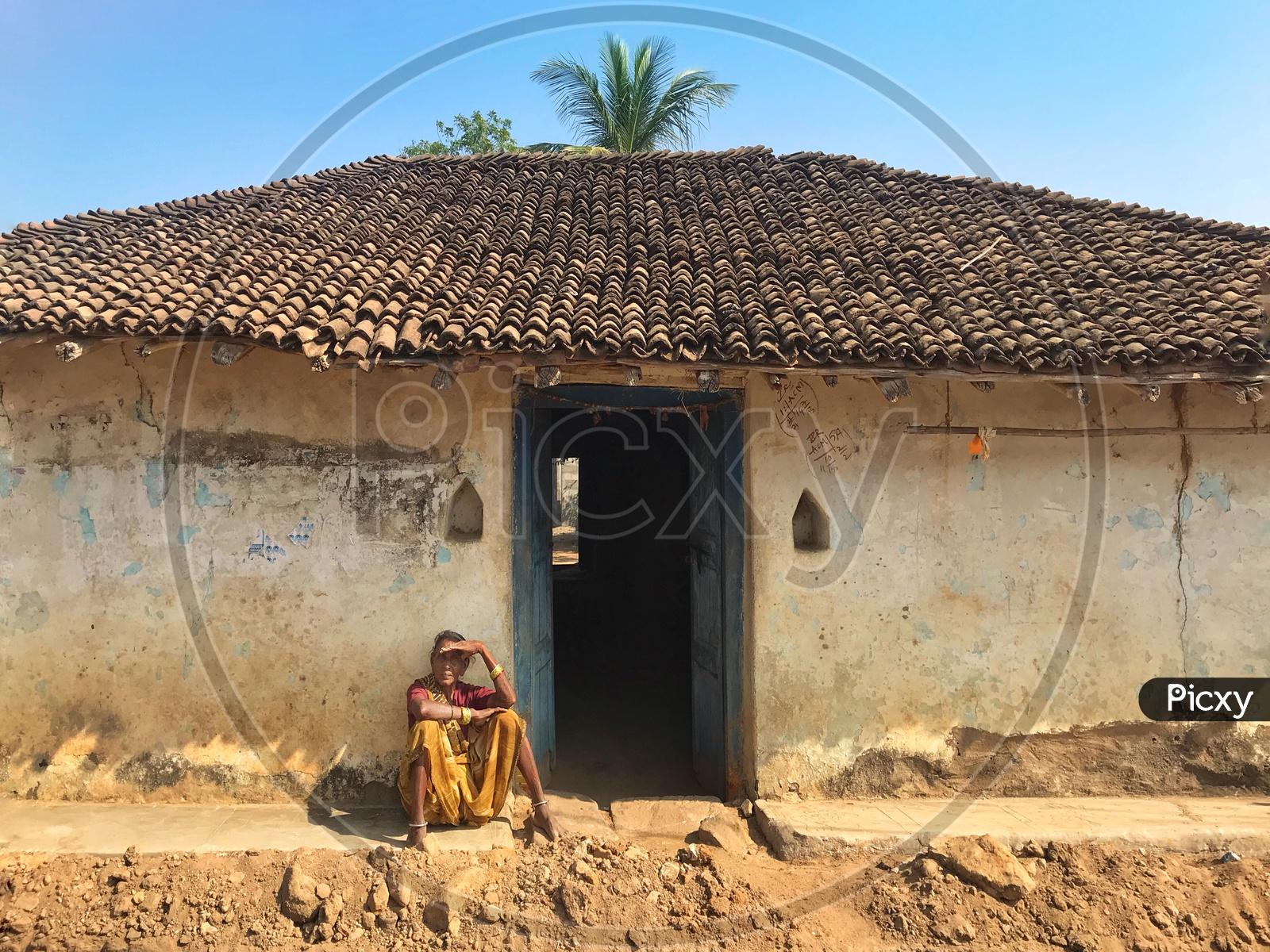 Villager woman Waiting.
