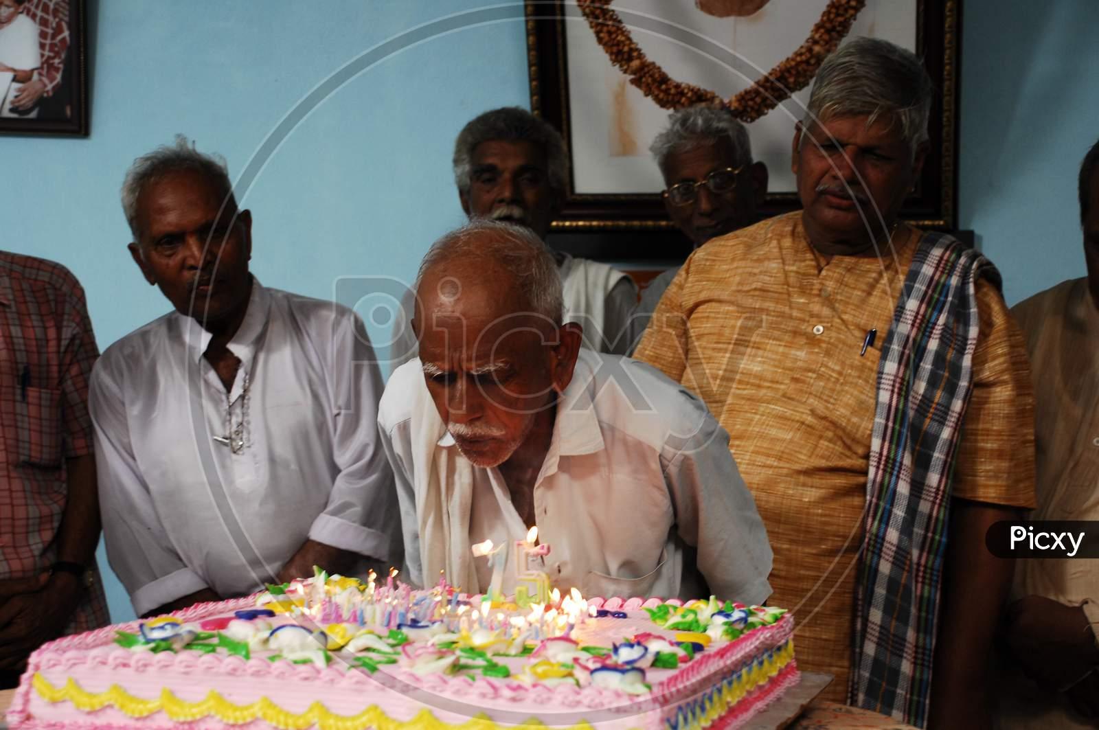Strange Image Of An Old Man Cutting Birthday Cake Bs574132 Picxy Personalised Birthday Cards Veneteletsinfo