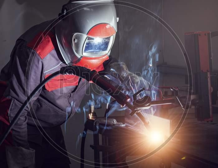 Welding Robots Movement In A Car Factory