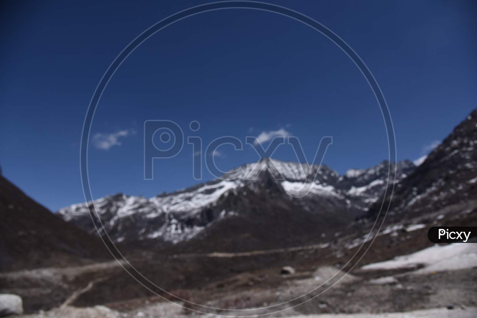 A Landscape n of Snow Filled Mountain Ranges With Valleys In  Arunachal Pradesh