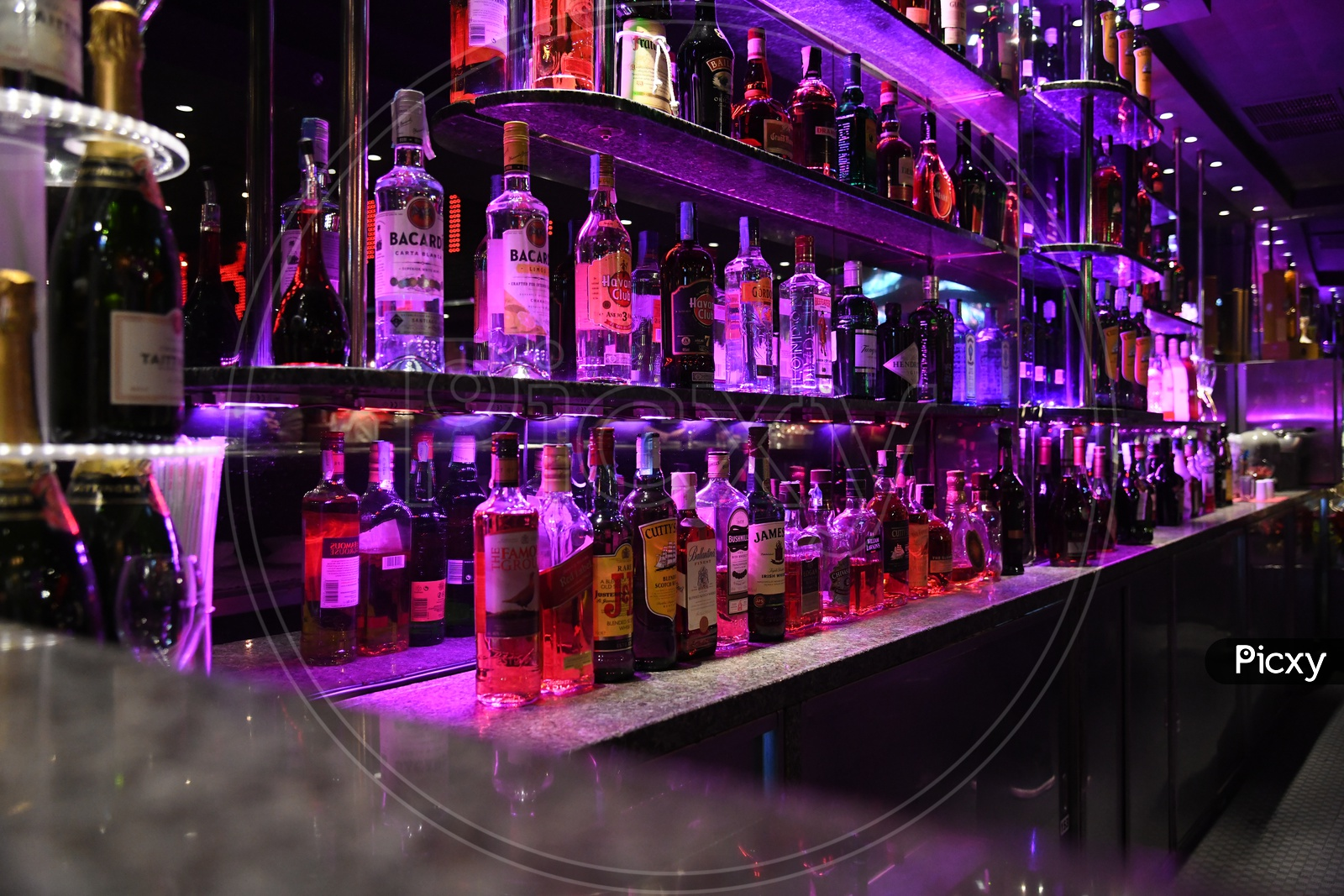 Alcohol Or Wine Bottles At A Bar Counter