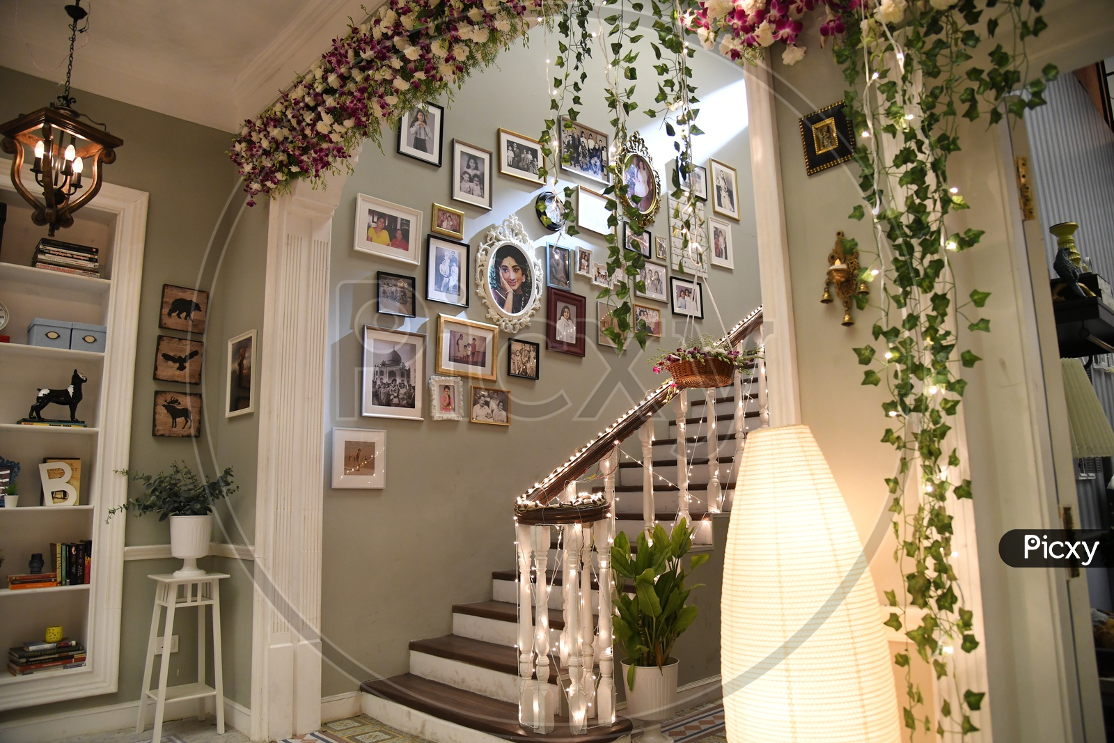 Interior Of a House Wall With Photo Frames And  Led Lights Decoration