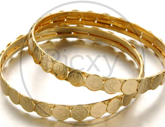 Flat gold oxidized woman's gold bangles