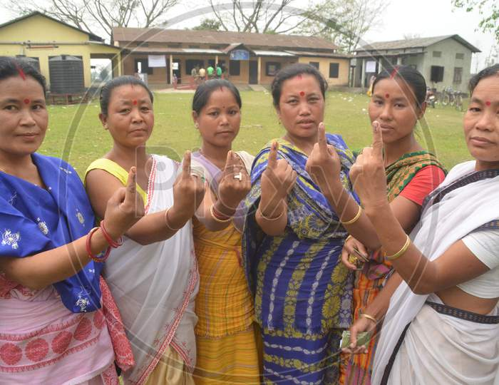 Assamese Woman  Showing  Inked Finger After Casting Vote  in Assembly Elections 2016