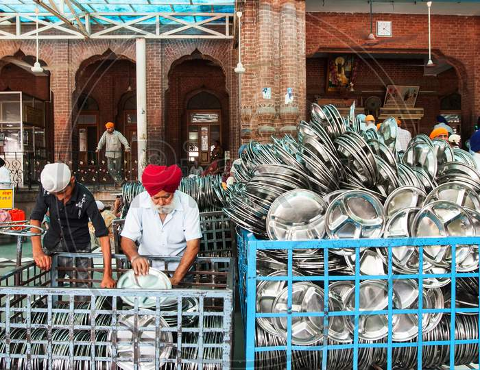 Utensils putting in order to serve at Langar, Amritsar