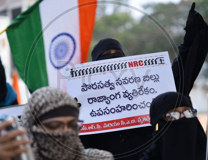 a muslim woman holds a placard at an all women protest against CAA and NRC on 27th December 2019