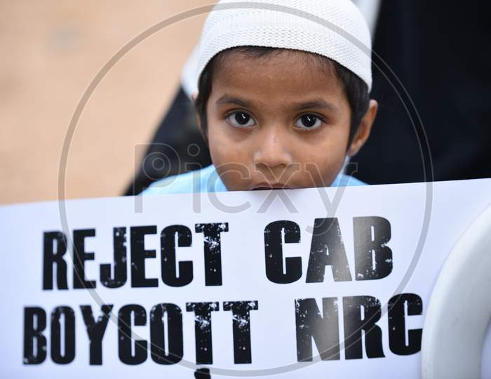 a muslim kid holds a placard at an all women protest against CAA and NRC on 27th December 2019