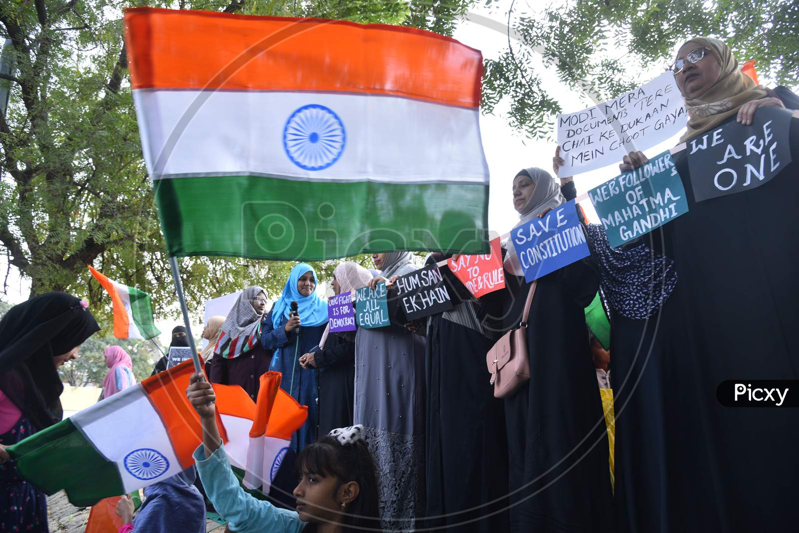 a muslim girl child holds an Indian flag at an all women protest against CAA and NRC on 27th December 2019