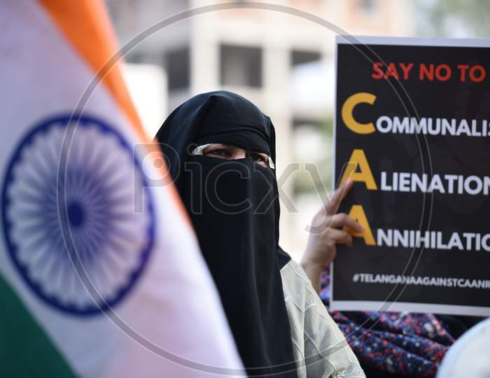 A muslim woman holds Indian Flag at an all women protest against CAA and NRC on 27th December 2019