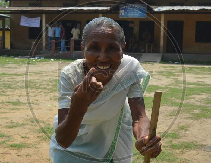 An Elderly Woman Showing Inked Finger After Casting Vote In  Assam Assembly General Elections 2016