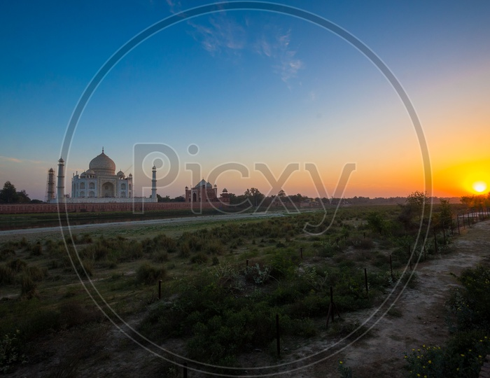 Landscape of Taj Mahal with beautiful sunset in the Background