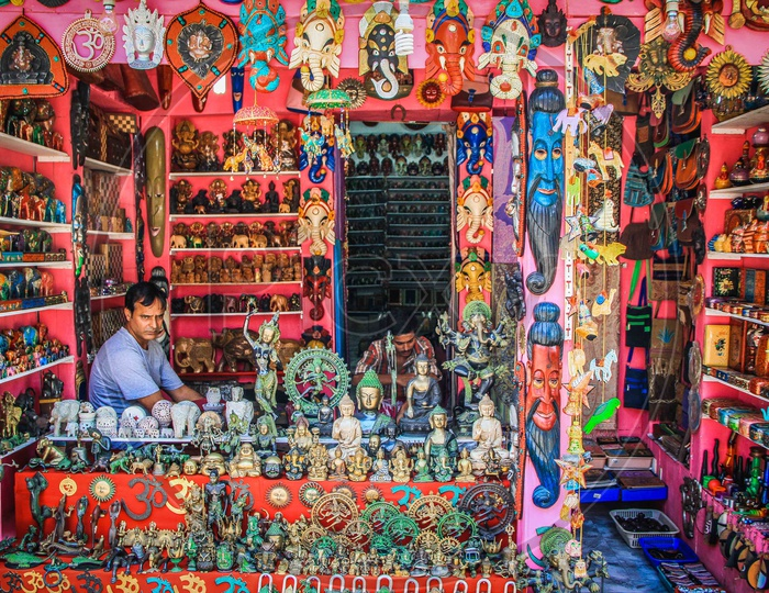 A shop with decorative items and a seller in it