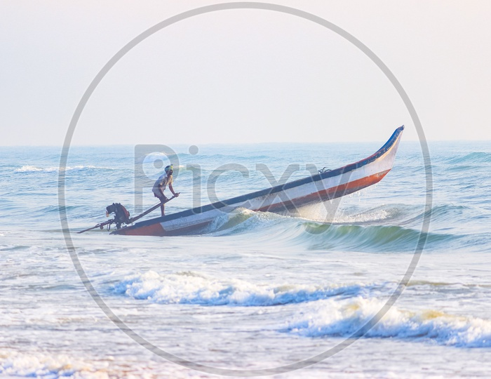 A man sailing in a boat against waves in sea