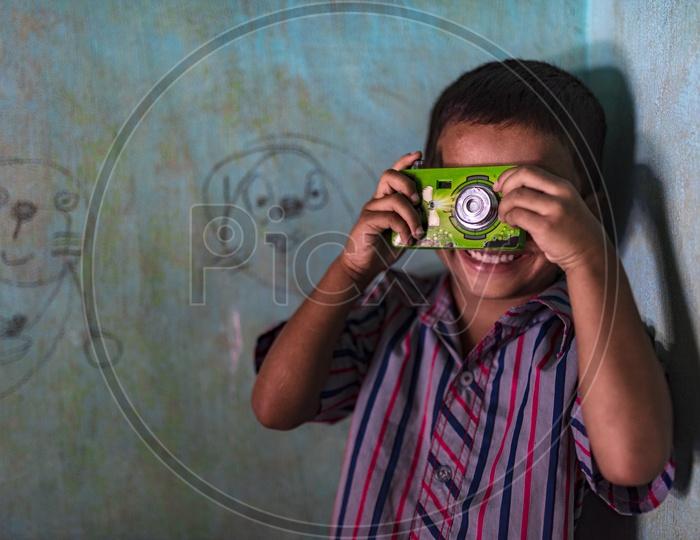 Smiling kid clicking photos