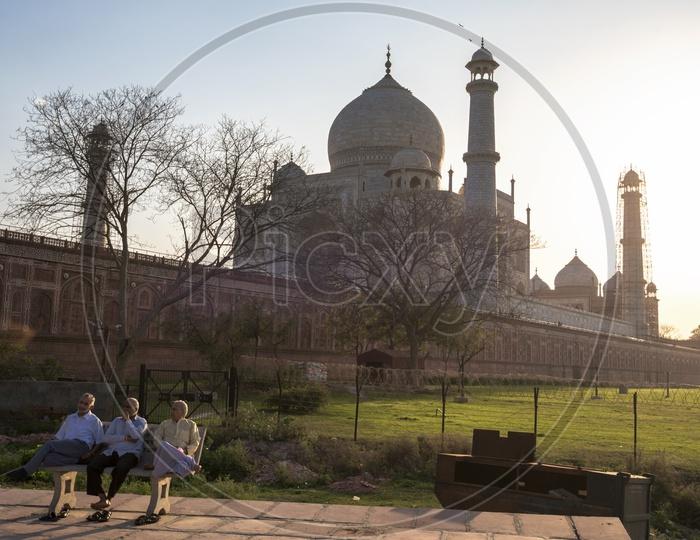 Old People sat on Bench near Taj Mahal