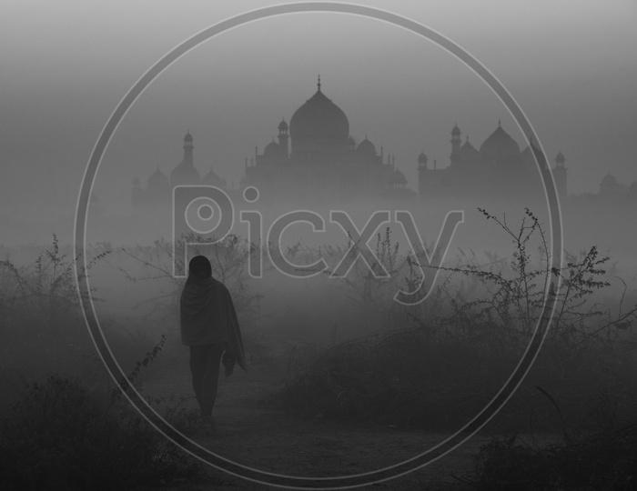 Man walking in Early Morning near Taj Mahal