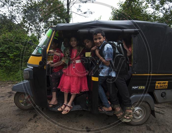 School Children in a Auto
