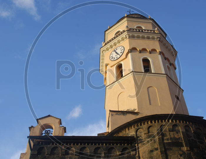 Clock tower with blue sky in background