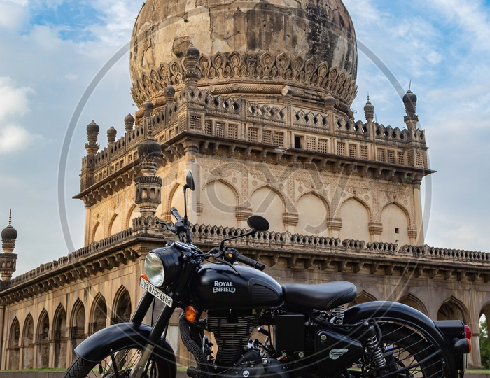 Royal Enfield Bike in front of Qutb Shahi Tombs