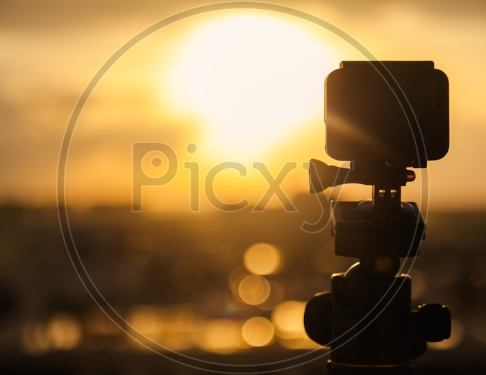 Silhouette of a Gopro Action Camera  Mounted to a  Tripod