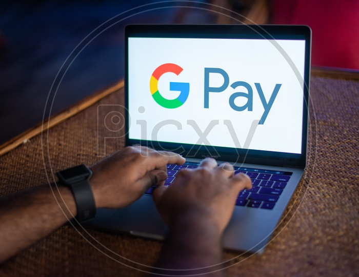 Indian Youth Accessing Google Pay ( G Pay )   in Laptop