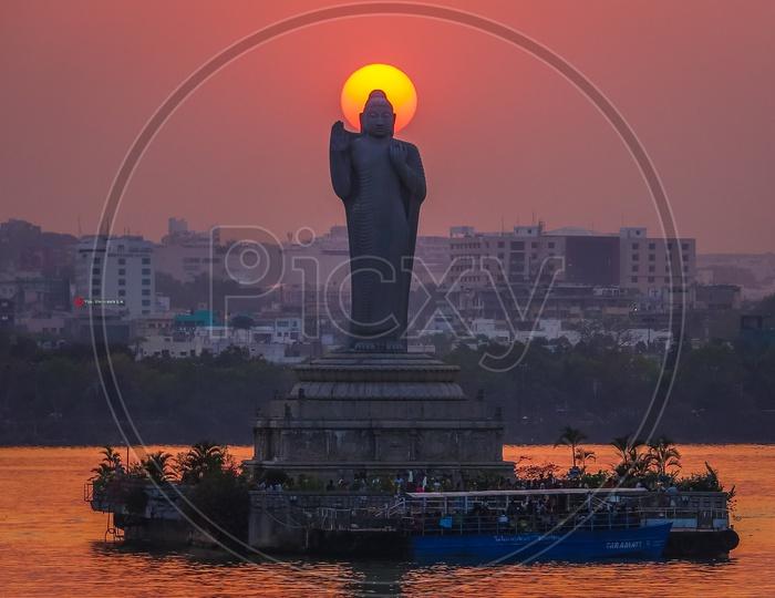 Buddha Statue in Hussain Sagar and Sunset in Background