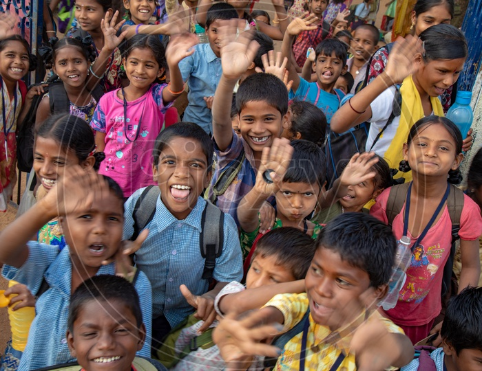 Indian School Children Happily Smiling And Waving