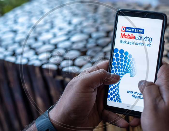 Indian Man using HDFC Mobile Banking App  in Smart Phone