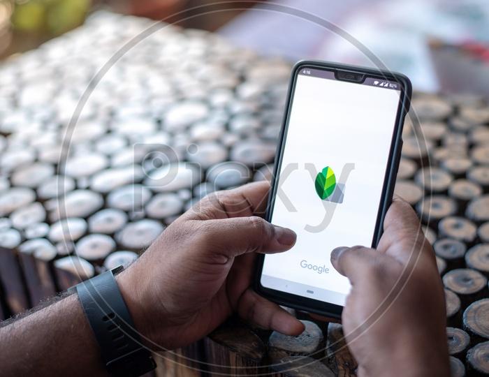 Indian Man using Snapseed App in  in Smart Phone