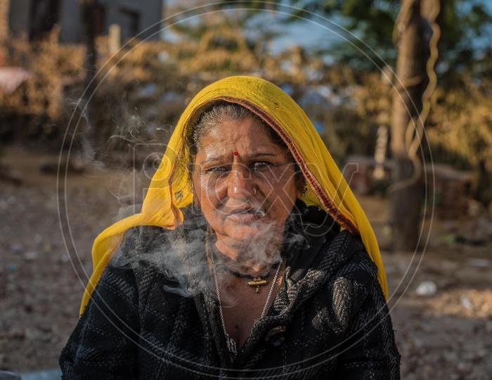 A Gypsy women and smoke