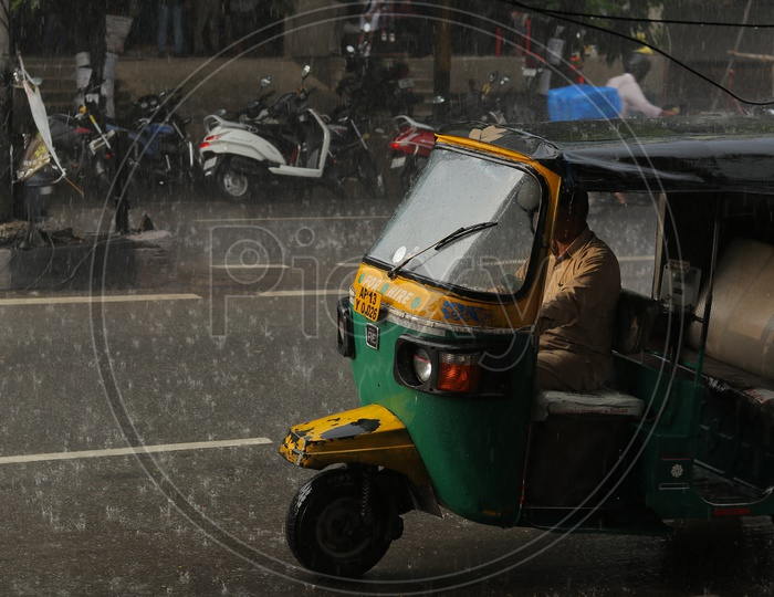 Auto moving on hyderabad roads on a rainy day