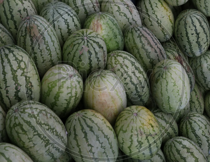 Watermelons arranged in Manner In a Vendor Stall